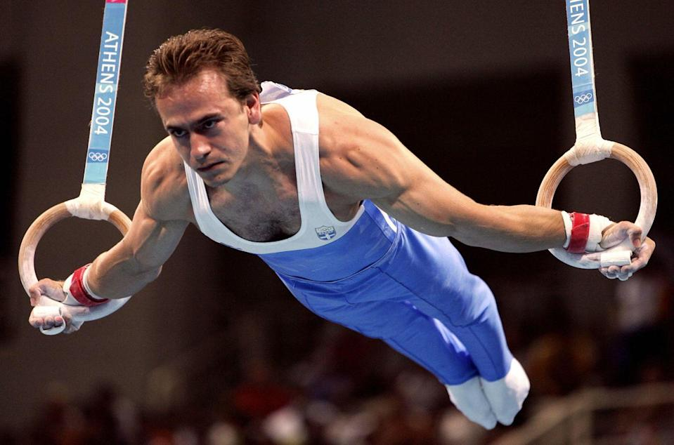 <p>Greek athlete Dimosthenis Tampakos won a gold medal for his performance on the rings at the Athens games. </p>