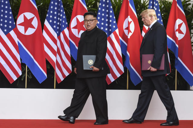 <p>North Korea leader Kim Jong Un and U.S. President Donald Trump walk with the documents they just signed at the Capella resort on Sentosa Island Tuesday, June 12, 2018 in Singapore. (Pool Photo by Anthony Wallace via AP) </p>