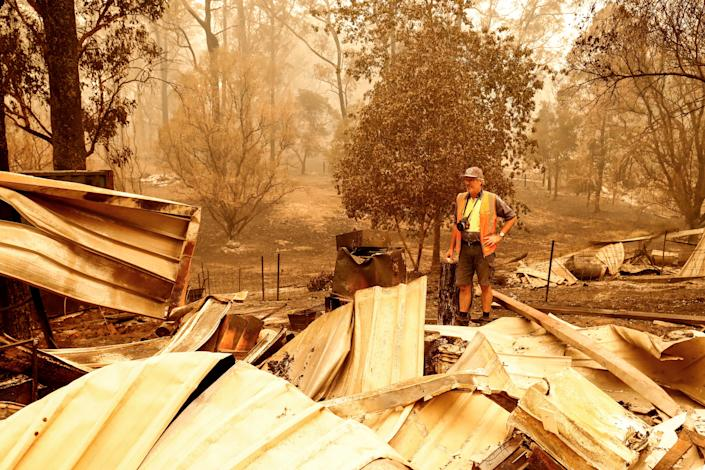 Sarsfield resident Wayne Johnston inspects damage to his property in Sarsfield, Australia.