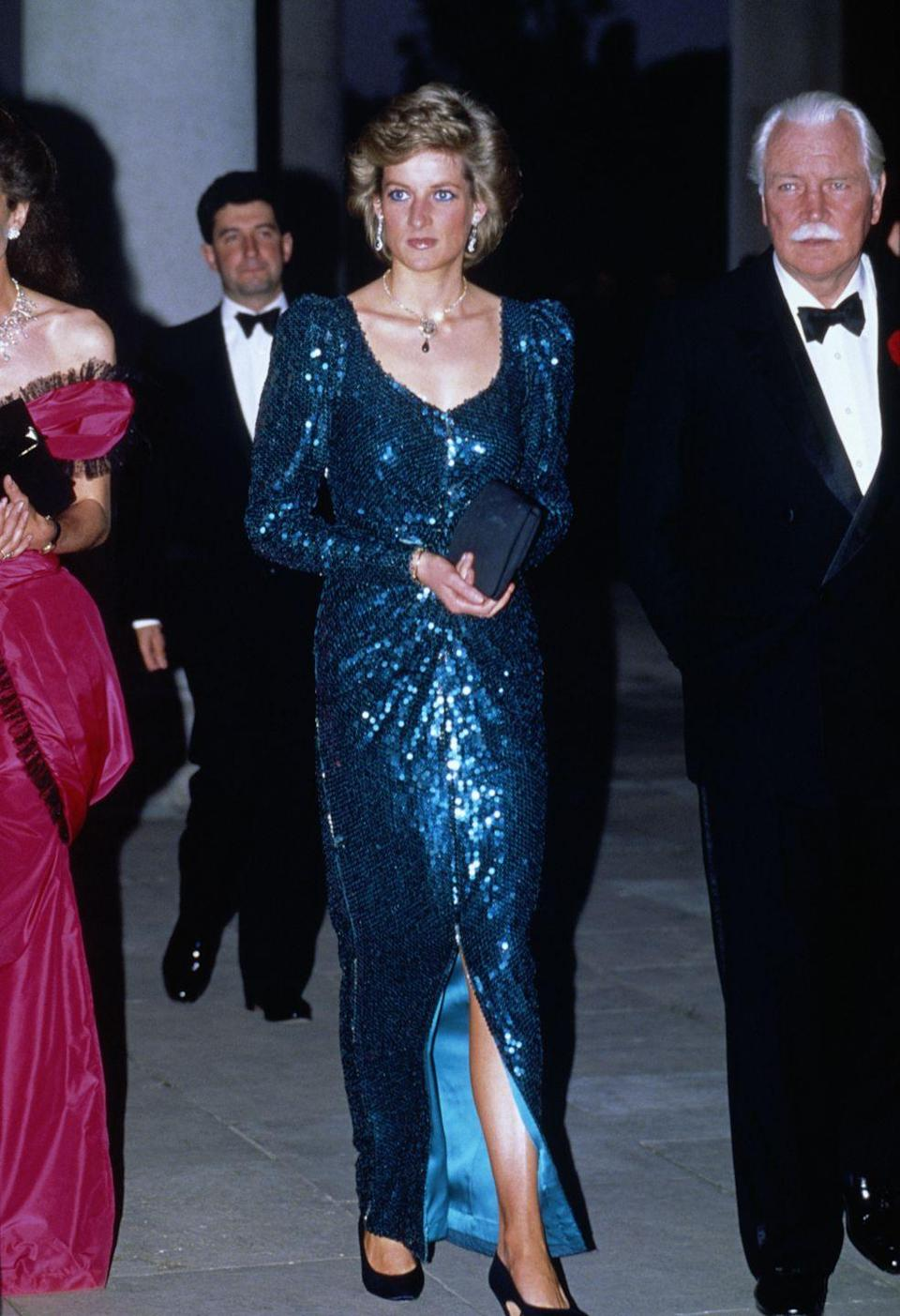 <p>In a sequin blue gown by Catherine Walker at a charity event in Middlesex. </p>