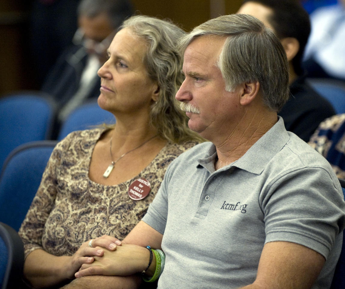 Ron Thomas and his wife Dana Pape listen during the arraignment of Fullerton police officer Manuel Ramos in Santa Ana, Calif., Monday, Sept. 26, 2011. Ramos has pleaded not guilty to second-degree murder in the death of a mentally ill homeless man after a violent arrest that eventually involved five other officers. (AP Photo/Paul Bersebach, Pool)