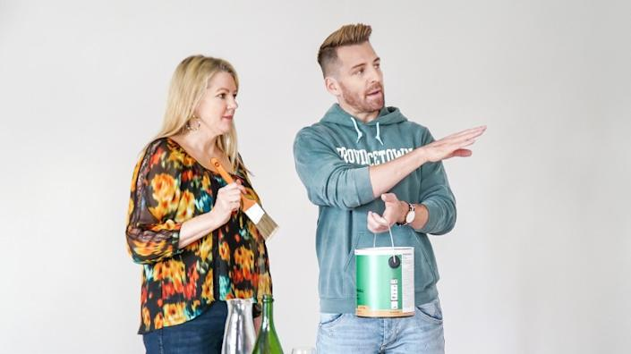 "HGTV's ""Build Me Up"" host Orlando Soria enlists the help of homeowner Eileen for a paint project in her master bedroom. <span class=""copyright"">(HGTV)</span>"