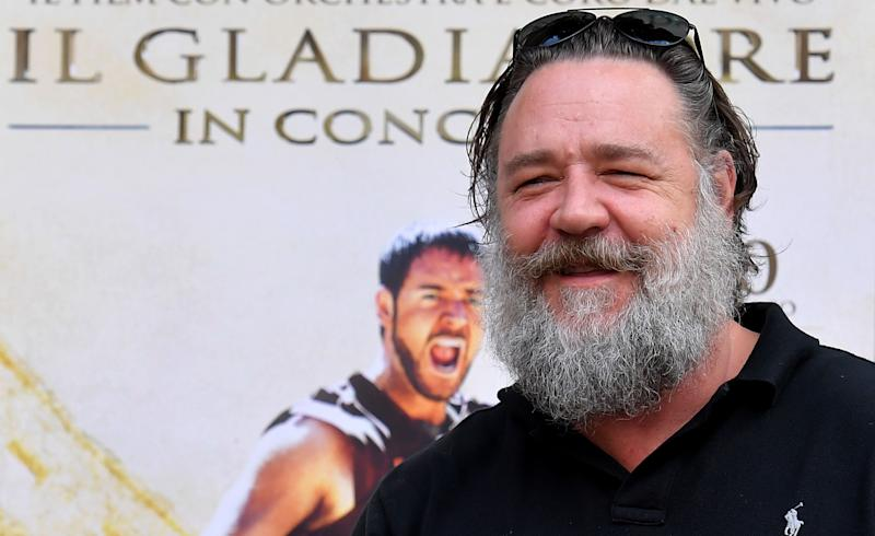 """New Zealand's actor Russell Crowe poses during a photocall promoting the charity screening of the award-winning 2000-released blockbuster """"Gladiator"""" on June 5, 2018 in Rome. (Photo by Tiziana FABI / AFP) (Photo credit should read TIZIANA FABI/AFP via Getty Images)"""