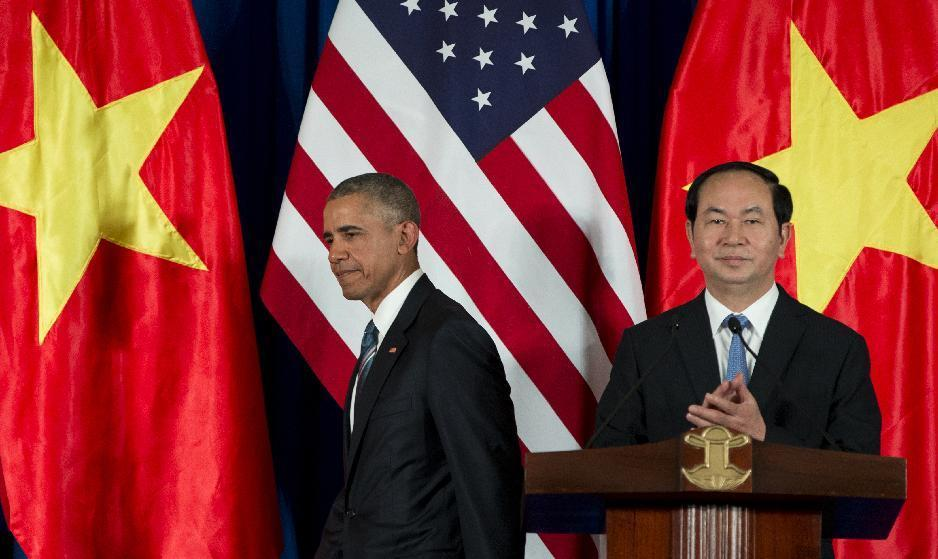 President Barack Obama and Vietnamese President Tran Dai Quang arrives for a news conference, Monday, May 23, 2016, at the International Convention Center in Hanoi, Vietnam. (AP Photo/Carolyn Kaster)