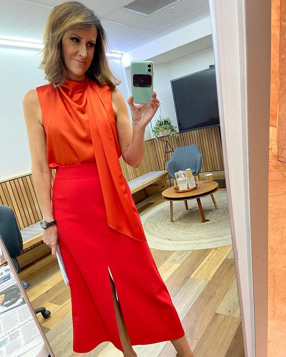 Natalie Barr in a red outfit backstage at Sunrise