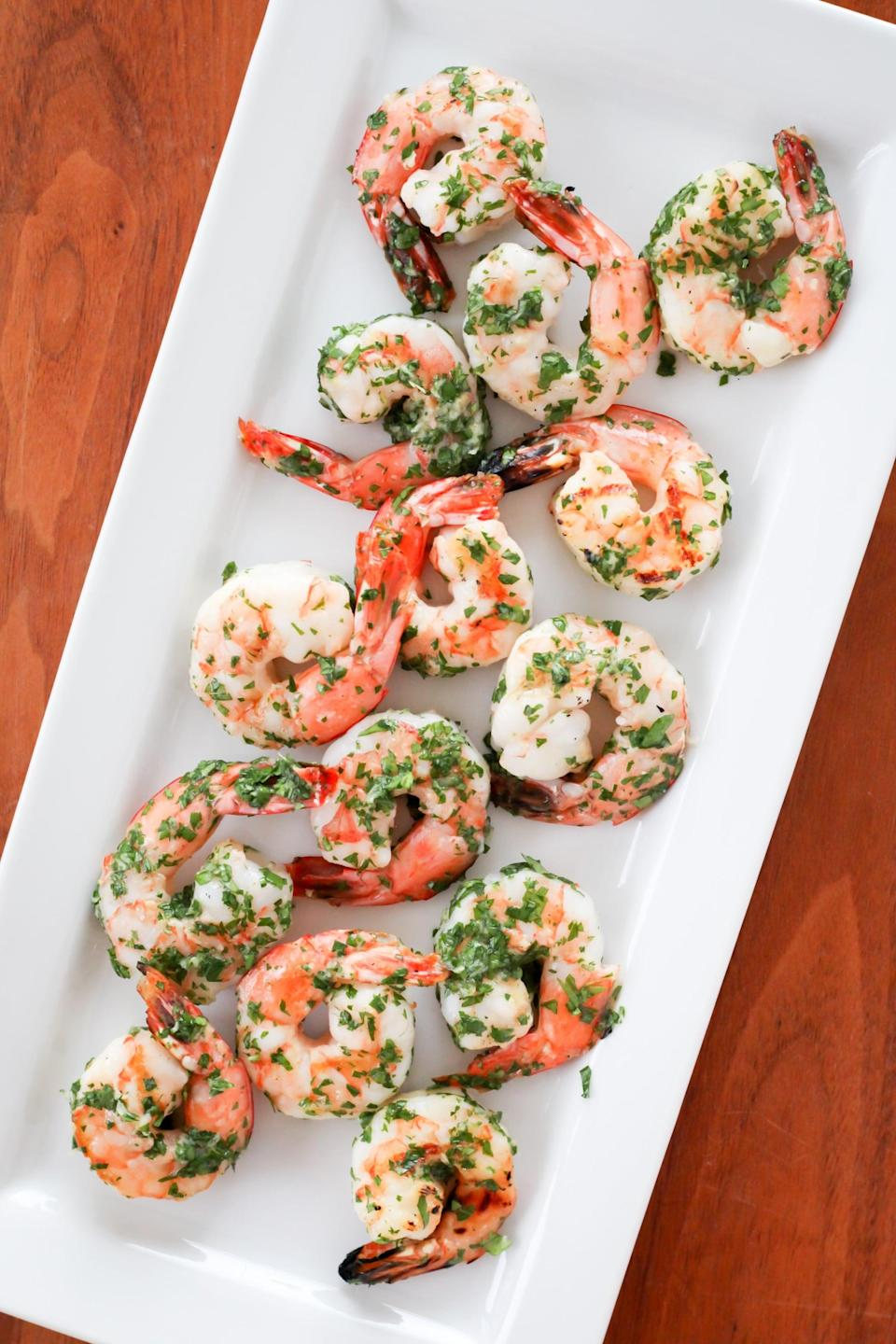 "<p>Spread a homemade gremolata, an herb sauce with garlic and lemon, all over the shrimp once they've been grilled for an easy boost of flavor. </p> <p><strong>Get the recipe:</strong> <a href=""https://www.popsugar.com/fitness/Easy-Recipe-Grilled-Shrimp-42368633"" class=""link rapid-noclick-resp"" rel=""nofollow noopener"" target=""_blank"" data-ylk=""slk:grilled shrimp with gremolata"">grilled shrimp with gremolata</a></p>"