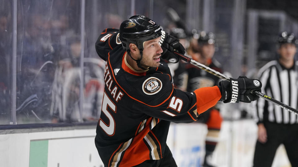 The Ducks' Ryan Getzlaf hits the puck during the second period of a preseason NHL hockey game against the Sharks on Thursday. (AP Photo)