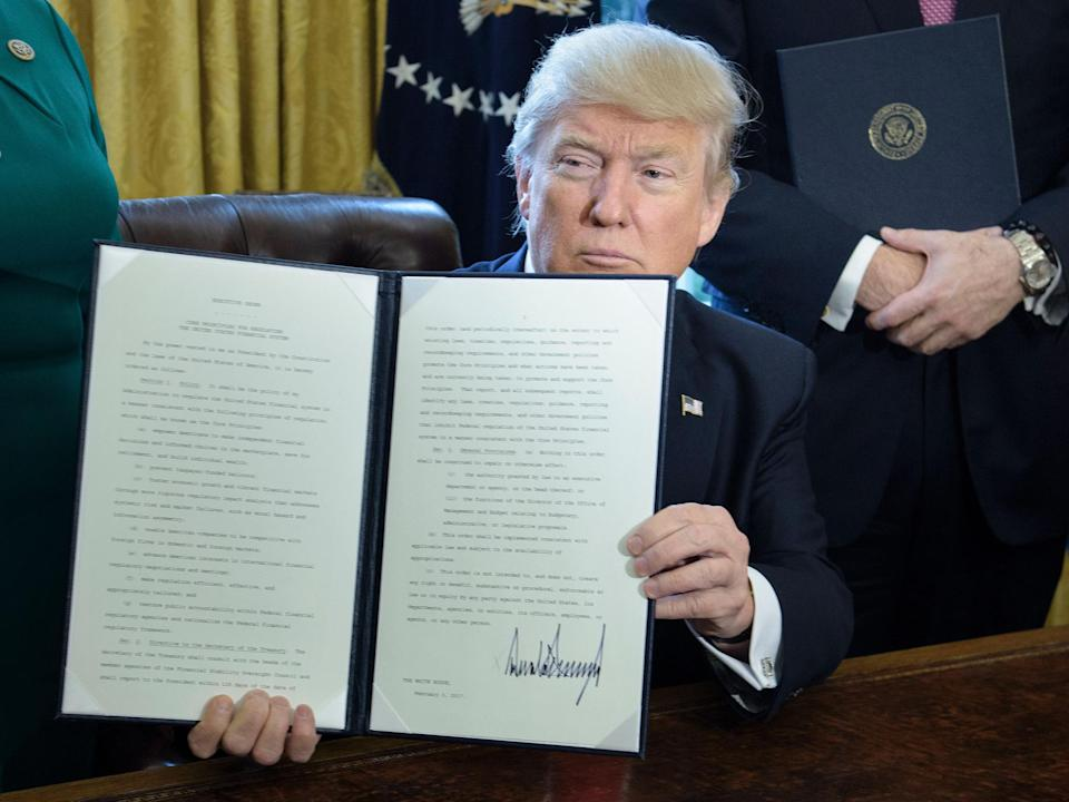 Trump shows executive order aimed at 'cutting a lot out of' Dodd Frank: Brendan Smialowski/Getty