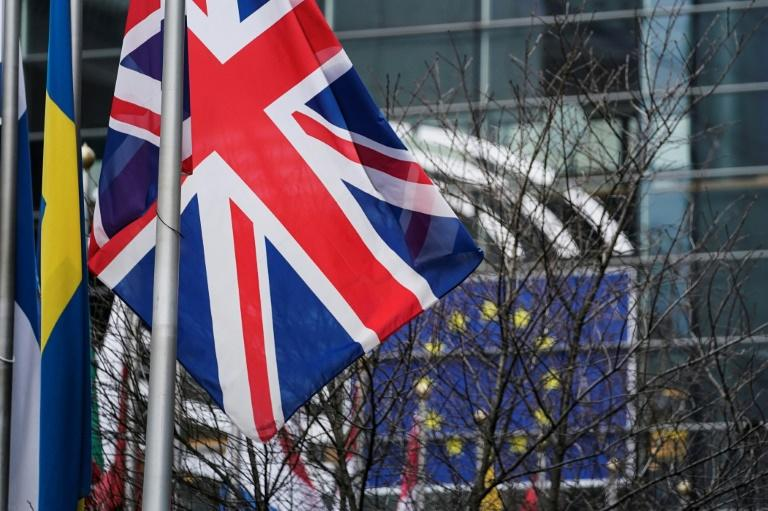 Britain's Union Jack flag will be lowered Friday as the country finally quits the EU (AFP Photo/Kenzo TRIBOUILLARD)