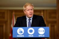 UK Prime Minister Boris Johnson holds a news conference at Downing Street in London