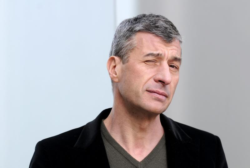 Italian artist Maurizio Cattelan poses Tuesday Jan. 29, 2008 during a press event at the Kunsthaus in Bregenz, Austria, where a exposition of his works will be on display from February 1, to March 24, 2008. (AP Photo/Keystone/Regina Kuehne)