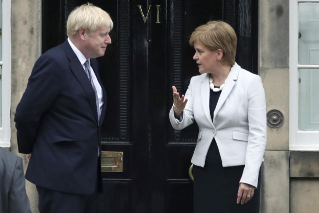 Prime minister Boris Johnson and Scottish first minister Nicola Sturgeon pictured last July (PA via AP)