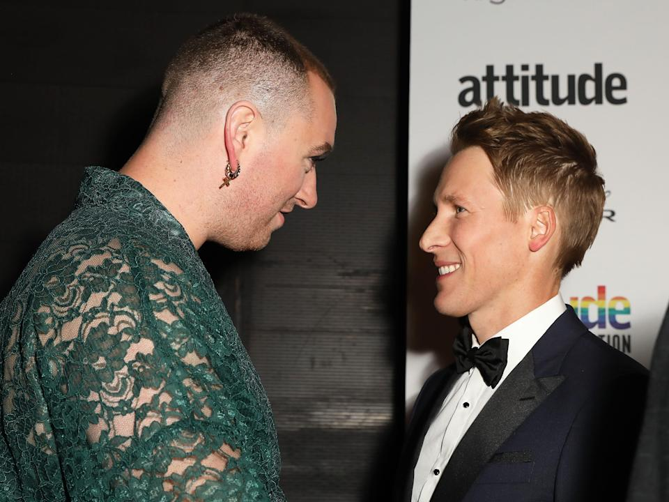 Sam Smith and Dustin Lance Black staring at each other