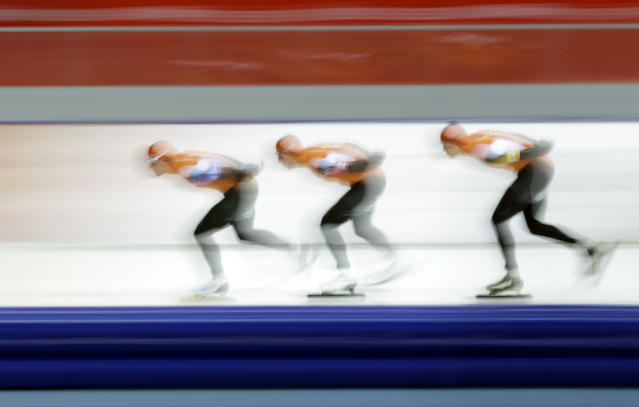 Speedskaters from the Netherlands Koen Verweij, Jan Blokhuijsen and Sven Kramer, from left to right compete in the men's speedskating team pursuit semifinals at the Adler Arena Skating Center at the 2014 Winter Olympics, Friday, Feb. 21, 2014, in Sochi, Russia. (AP Photo/Matt Dunham)