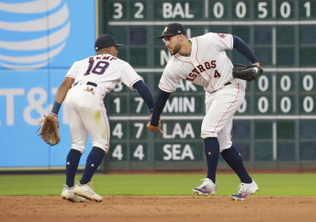 Houston Astros' Tony Kemp and George Springer celebrate after defeating the Texas Rangers 6-1 after a baseball game Saturday, July 20, 2019, in Houston. (AP Photo/Richard Carson)