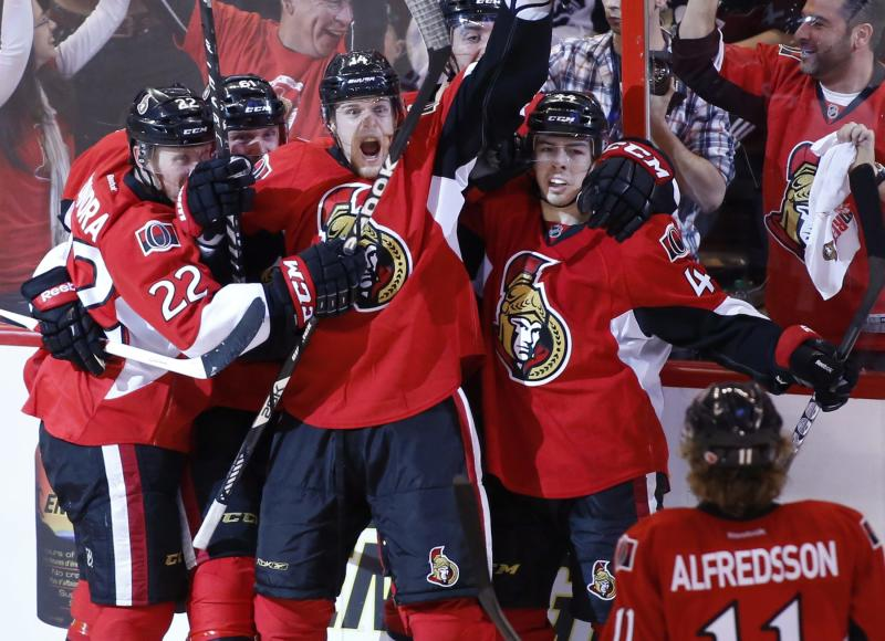 Ottawa Senators from left: Erik Condra, Andre Benoit, Colin Greening, Jean-Gabriel Pageau, and Daniel Alfredsson celebrate after Greening scores the winning goal against the Pittsburgh Penguins during the second overtime period of game four of their Stanley Cup Eastern Conference semi-final NHL hockey game at Scotiabank Place in Ottawa on Sunday, May 19, 2013.  (AP Photo/The Canadian Press, Patrick Doyle)