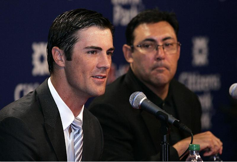 Philadelphia Phillies pitcher Cole Hamels, left, speaks during a news conference as team general manager Ruben Amaro, Jr. looks on Wednesday, July 25, 2012, in Philadelphia. Hamels and the Phillies have agreed to a $144 million, six-year contract that prevents the 2008 World Series MVP from becoming a free agent after the season. (AP Photo/Tom Mihalek)