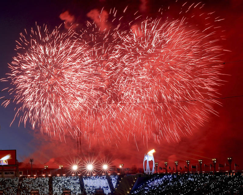 Fireworks detonate after the Olympic flame was lit during the opening ceremony (AP photo)