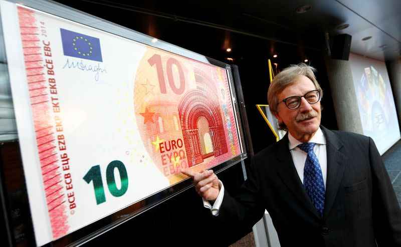 FILE PHOTO: Yves Mersch, Member of the Executive Board of the European Central Bank presents an oversized newly unveiled 10 euro note at the headquarters of the European Central Bank (ECB) in Frankfurt