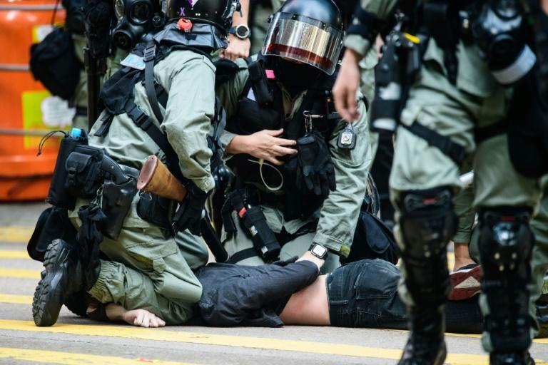 A man being detained by police during a protest in Hong Kong's Central district on November 11, 2019