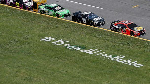 PHOTO: A sign is painted along the pit road in the grass reading, '#IStandWithBubba' prior to the NASCAR Cup Series GEICO 500 at Talladega Superspeedway, June 22, 2020 in Talladega, Ala. (Brian Lawdermilk/Getty Images)