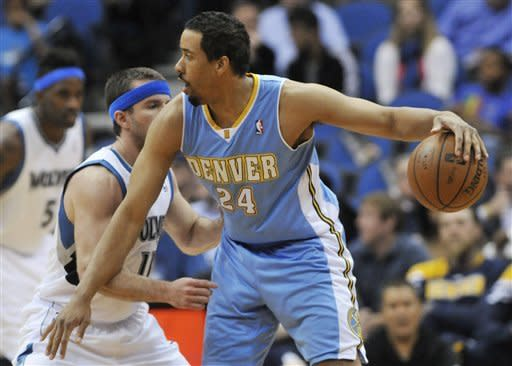Denver Nuggets' Andre Miller, right, keeps the ball away from Minnesota Timberwolves' J.J. Barea during the first half of an NBA basketball game Thursday, April 26, 2012, in Minneapolis. (AP Photo/Jim Mone)