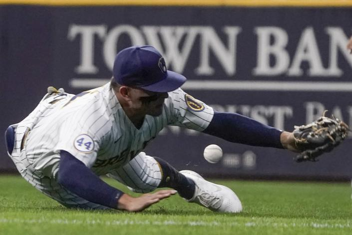 Milwaukee Brewers' Luis Urias can't catch a ball hit by St. Louis Cardinals' Edmundo Sosa during the third inning of a baseball game Friday, Sept. 3, 2021, in Milwaukee. (AP Photo/Morry Gash)