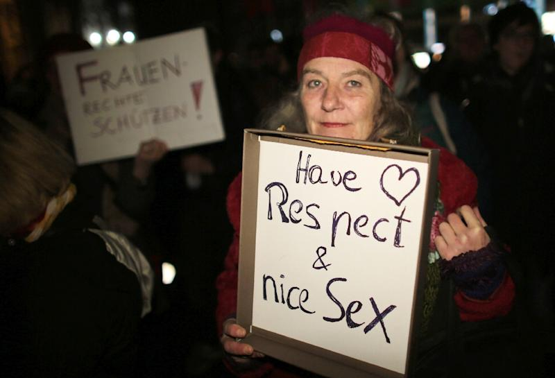A woman holds a sign during a demonstration in the German city of Cologne on January 5, 2016