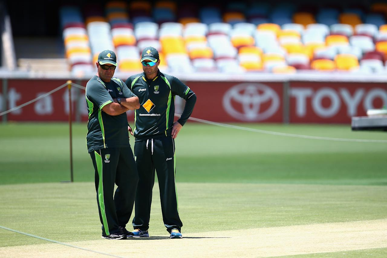 BRISBANE, AUSTRALIA - NOVEMBER 20:  Michael Clarke of Australia and Former Captain Mark Taylor inspect the pitch during an Australian Nets Session at The Gabba on November 20, 2013 in Brisbane, Australia.  (Photo by Ryan Pierse/Getty Images)