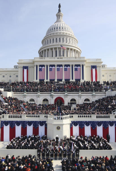 FILE - In this Jan. 20, 2009 file photo, President Barack Obama gives his inaugural address at the U.S. Capitol in Washington. Obama will raise his right hand and place his left on a Bible as he takes the oath of office for a second four-year term. His second inauguration promises the pageantry of the first, but on a smaller scale than 2009, when a record 1.8 million people filled the nation's capital to witness Obama making history as America's first black president. (AP Photo/Ron Edmonds, File)