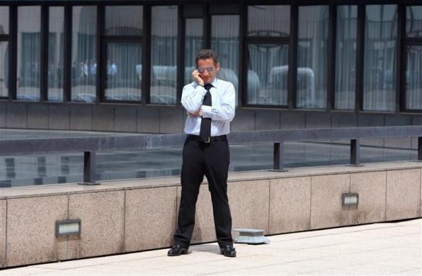 France's president Nicolas Sarkozy speaks on the telephone on the second day of a EU heads of states and governments summit in Brussels, June 22, 2007.