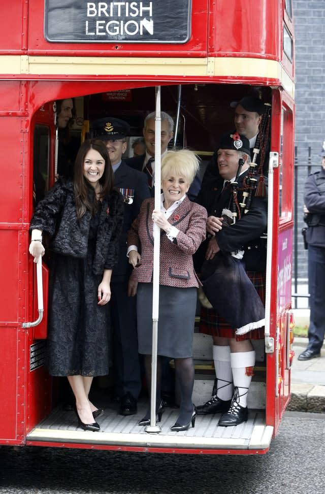 Barbara Windsor on a 1960s Routemaster bus