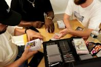 Traders try to strike deals on sports cards at Bleecker Trading in New York on July 06, 2021