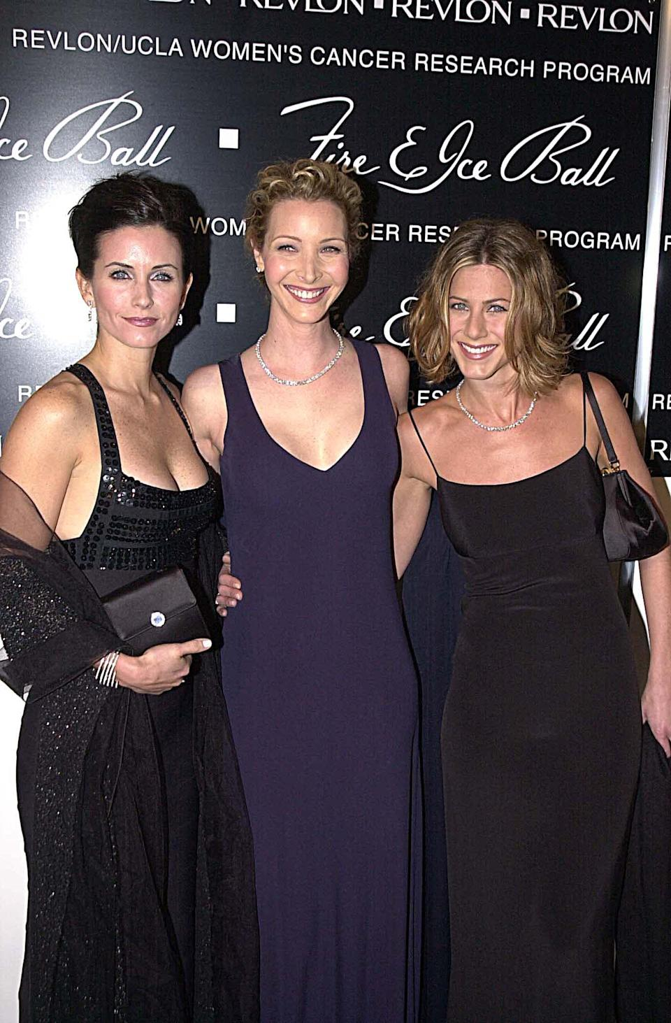 <p>Block colour dresses all round for the 'Friends' ladies at a ball in 2000.<em> [Photo: Getty]</em> </p>