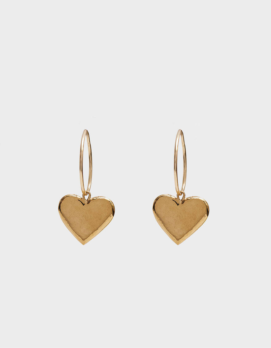 "Does your mom wear her heart on her sleeve? Now she can wear it in her ears, too, with sustainable jewelry brand Wolf Circus's adorable baubles. <br> <br> <strong>Wolf Circus</strong> Amourette Hoops in Gold, $, available at <a href=""https://go.skimresources.com/?id=30283X879131&url=https%3A%2F%2Fneedsupply.com%2Famourette-hoops-in-gold%2FW106925.html%23%26gid%3D1%26pid%3D1"" rel=""nofollow noopener"" target=""_blank"" data-ylk=""slk:Need Supply"" class=""link rapid-noclick-resp"">Need Supply</a>"