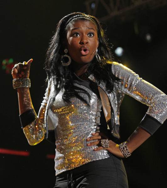 Singer Coco Jones performs at the Essence Music Festival in New Orleans, Thursday, July 5, 2012. This is the first day of the four day music festival. (Photo by Bill Haber/Invision/AP)