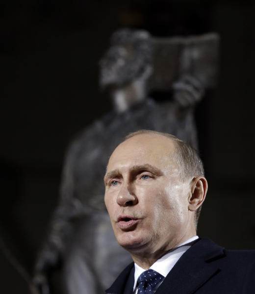 Russian President Vladimir Putin delivers a speech near a statue of 19th century Russian poet Alexander Pushkin during its unveiling ceremony in Seoul, South Korea, Wednesday, Nov. 13, 2013. Putin arrived in Seoul on Wednesday for a one-day visit for his second summit talks with South Korean President Park Geun-hye. (AP Photo/Lee Jin-man)