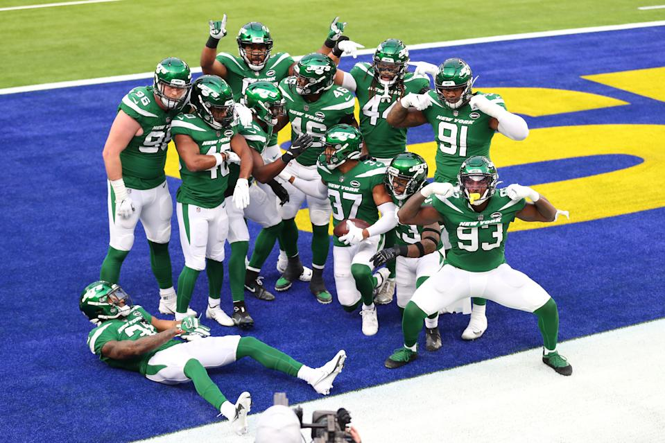 The New York Jets pose for a photo following a touchdown during the first quarter of a game against the Los Angeles Rams at SoFi Stadium.