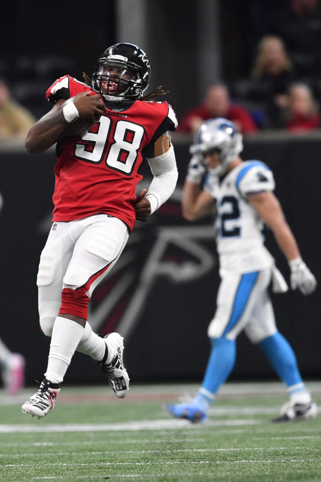 Atlanta Falcons defensive end Takkarist McKinley (98) celebrates on a defensive play against the Carolina Panthers during the second half of an NFL football game, Sunday, Dec. 8, 2019, in Atlanta. (AP Photo/John Amis)