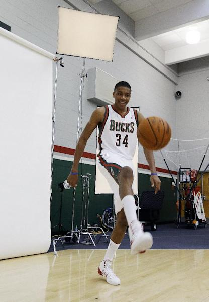 Milwaukee Bucks first-round draft pick Giannis Antetokounmpo, of Greece, dribbles a basketball with his foot during the team's NBA basketball media day Monday, Sept. 30, 2013, in St. Francis, Wis. (AP Photo/Morry Gash)