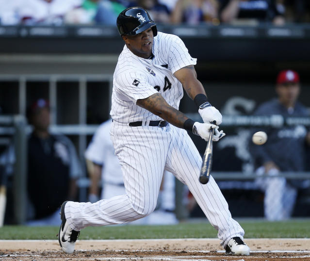 Chicago White Sox's Dayan Viciedo hits a single against the Seattle Mariners during the second inning of a baseball game on Friday, July 4, 2014, in Chicago. (AP Photo/Andrew A. Nelles)