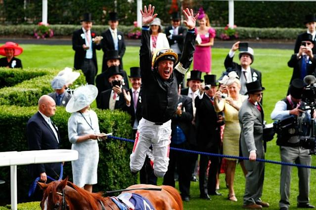 If Stradivarius wins his third successive Ascot Gold Cup and gives Dettori his eighth win in the race the Italian has said there will be no trademark flying dismount due to the lack of a crowd. (AFP Photo/Adrian DENNIS)