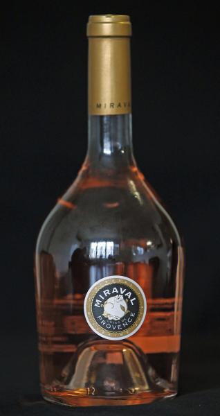 A bottle of Miraval, Cote de Provence rose wine is displayed in Paris, Thursday March 7, 2013. The first wine to be sold from a French vineyard owned by Hollywood couple Brad Pitt and Angelina Jolie goes on offer today to online buyers.(AP Photo/Remy de la Mauviniere)