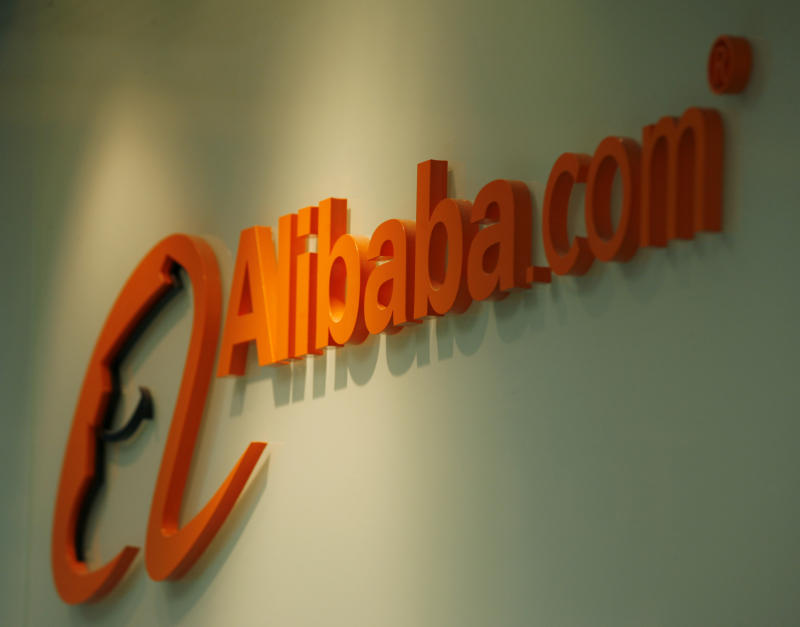 A company logo of Alibaba.com is displayed at its Hong Kong office March 16, 2010. Alibaba.com, China's largest e-commerce company, posted a 49 percent rise in quarterly net profit as revenue growth accelerated on the back of strong customer additions. REUTERS/Bobby Yip (CHINA - Tags: BUSINESS)