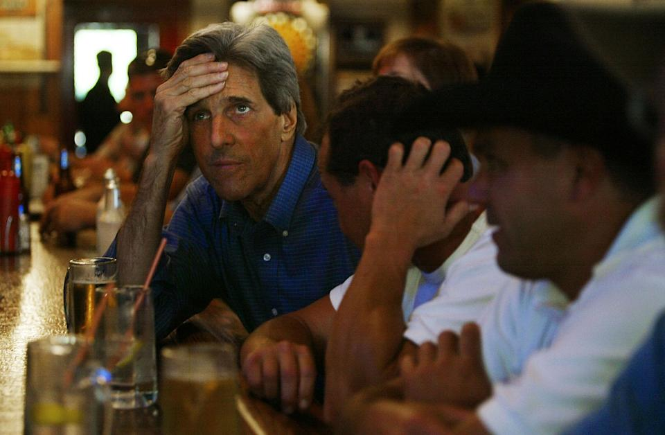 <p>Democratic presidential candidate Sen. John Kerry watches the Green Bay Packers game at a bar September 26, 2004 in Mt. Horeb, Wisconsin. Kerry is planning to stay in Wisconsin for three days as he prepares for the debate against President George W. Bush. (Photo by Chris Hondros/Getty Images) </p>