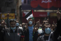 Palestinian Hamas supporters chant anti Israel slogans during a protest in solidarity with Muslim worshippers in Jerusalem, in Gaza City, Friday, April. 23, 2021. (AP Photo/Khalil Hamra)