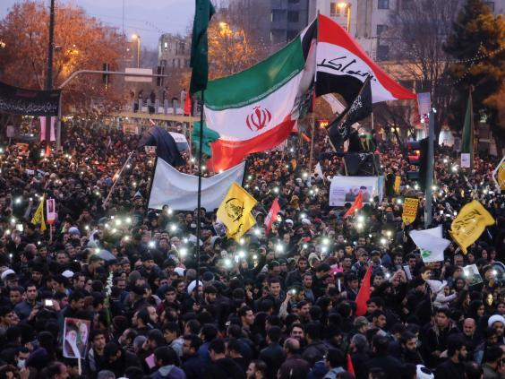 Iranians gather in the northeastern city of Mashhad (AFP)
