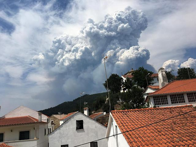 <p>Smoke from a forest fire is seen from the village of Dornes, in central Portugal, June 18, 2017. (Axel Bugge/Reuters) </p>