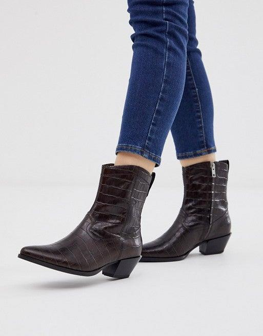 """<br><br><strong>Vagabond</strong> Emily Mid Heeled Ankle Boots, $, available at <a href=""""https://go.skimresources.com/?id=30283X879131&url=https%3A%2F%2Fwww.asos.com%2Fus%2Fvagabond%2Fvagabond-emily-mid-heeled-ankle-boots-in-brown-croc-leather%2Fprd%2F12861606"""" rel=""""nofollow noopener"""" target=""""_blank"""" data-ylk=""""slk:ASOS"""" class=""""link rapid-noclick-resp"""">ASOS</a>"""