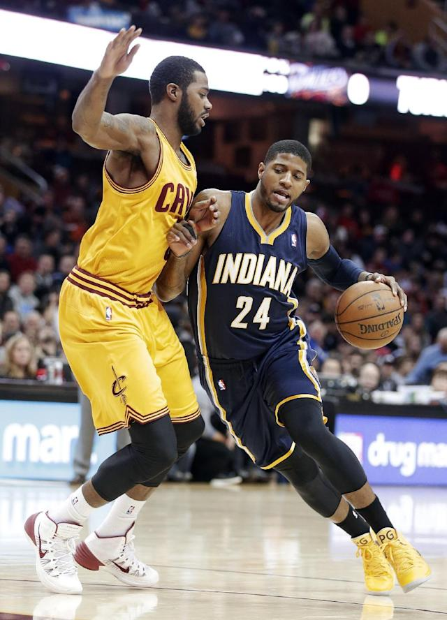 Indiana Pacers' Paul George (24) drives past Cleveland Cavaliers' Earl Clark during the first quarter of an NBA basketball game Sunday, Jan. 5, 2014, in Cleveland. (AP Photo/Tony Dejak)
